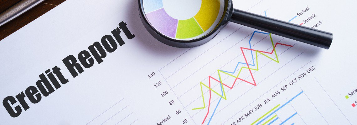 Credit Report with graphs and a magnifying glass
