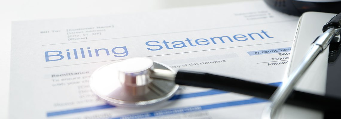Stethoscope resting on a billing statement