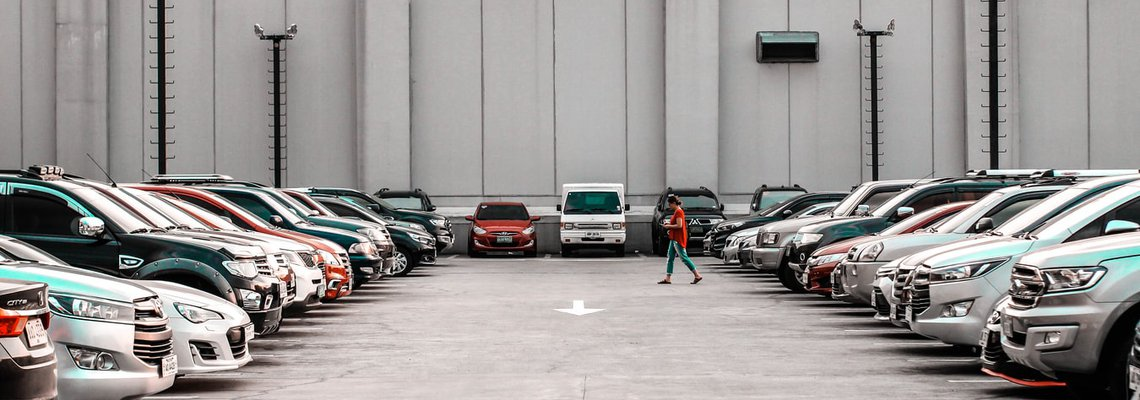 Person walking through parking lot