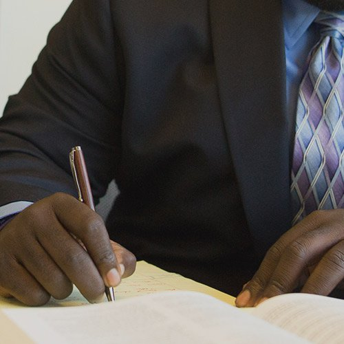 Man writing on documents