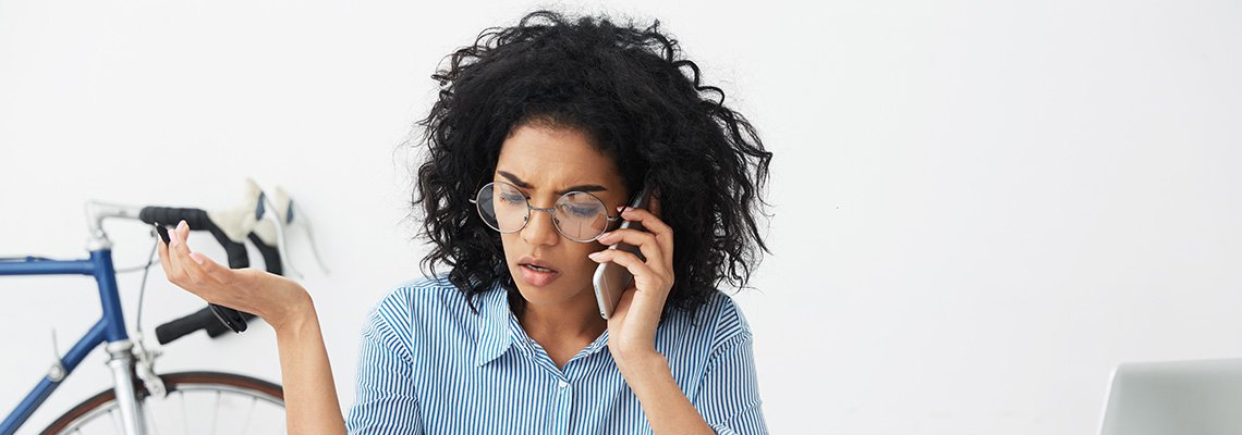 A frustrated woman talks on her cell phone