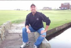 Attorney Scott Andresen taking a break from the normal routine at the Swilcan Bridge at St, Andrews Links in Scotland.
