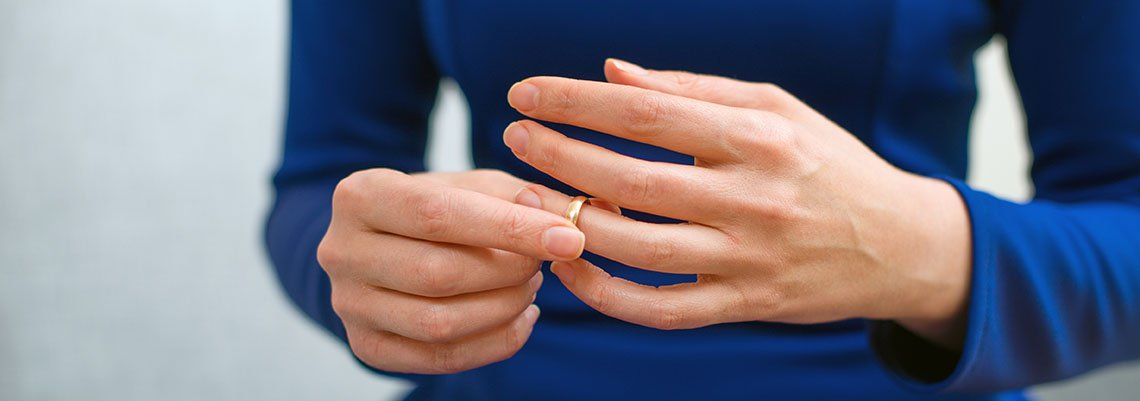 Woman removing a wedding ring