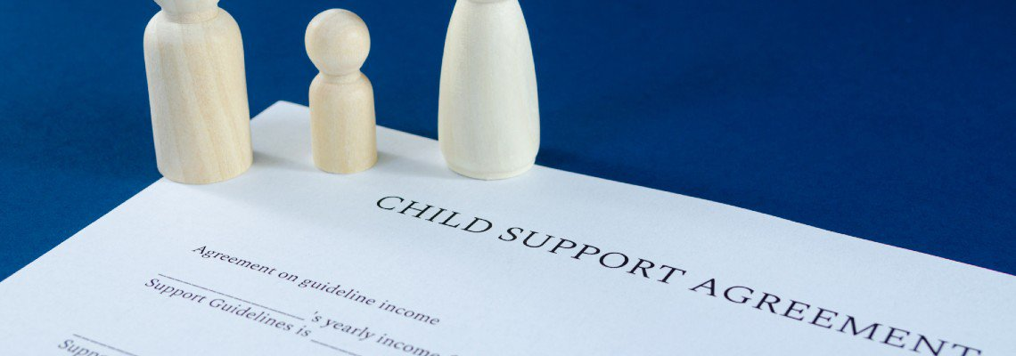 Wood figures on a child support document