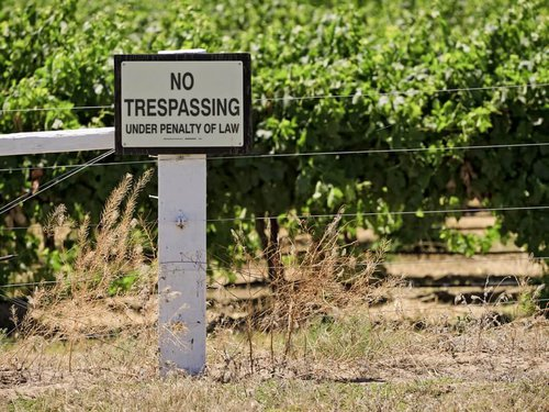 No-Trespassing-Sign-On-The-Pro-225922132.jpg