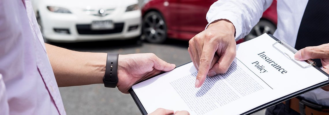 Insurance adjuster working with client after auto accident