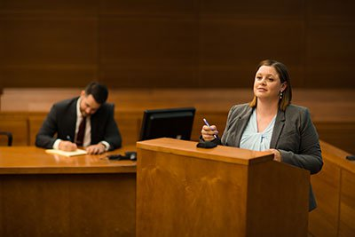 Attorney Katherine Wolfe Standing at a Court Podium