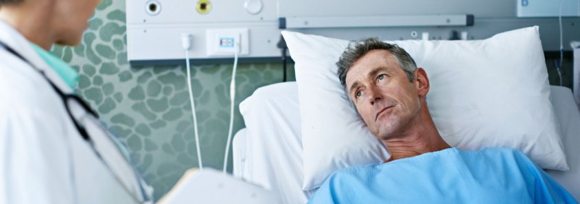Elderly Man Lying in a Hospital Bed