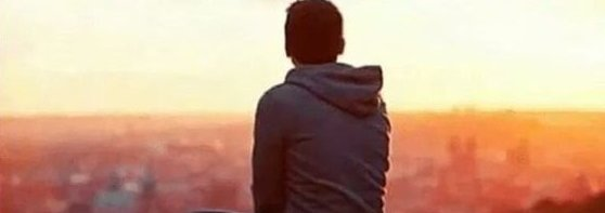 Man Looking At the City view under Sunset