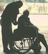 Man Talking to an Elderly in a Wheelchair