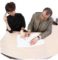 Man and Woman Reviewing Document