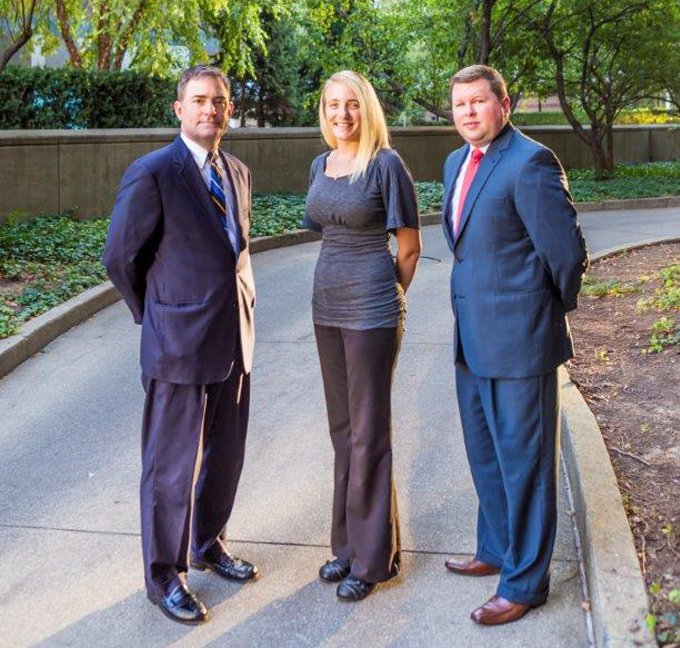 Attorneys David M. Schuler and Justin P. Gooch and paralegal