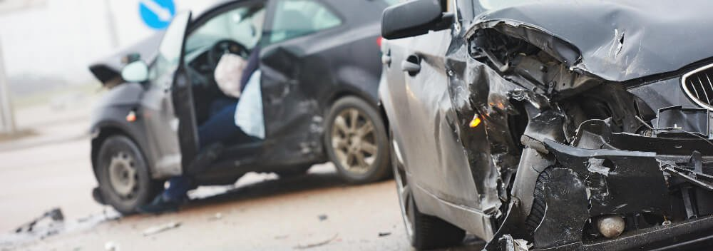 Two damaged cars following a car accident