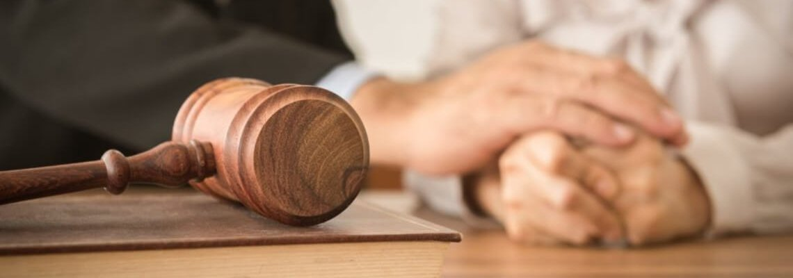 Person Being Comforted, Gavel is resting on a book in front of them