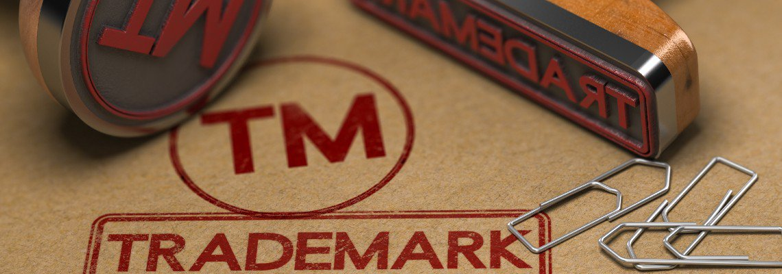 Red TM and Trademark stamps on a folder