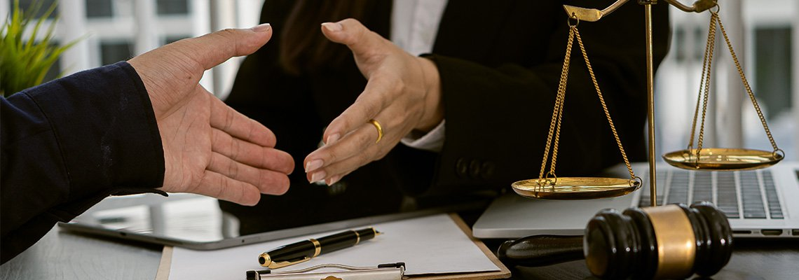 Two Hands Preparing to Shake over Paper on Clipboard with Pen