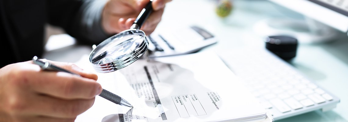 A person investigates business documents
