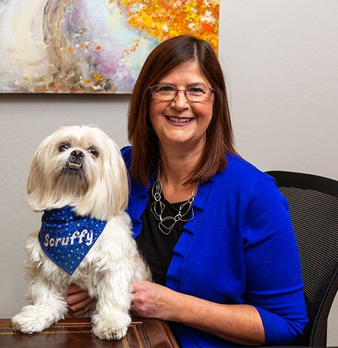Attorney Theresa Seifert and Scruffy the dog