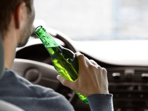 Man drinking and driving