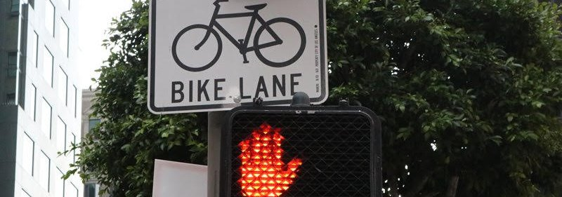 Bike Lane sign and a No Walking hand
