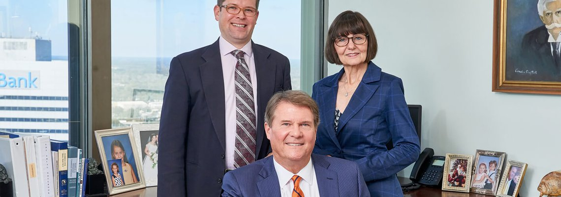 Attorneys Scott Sheftall and Brian Moore and Paralegal Lynda Weeden