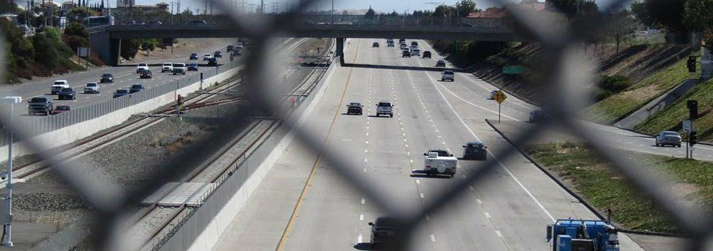 Chain link fence above a highway