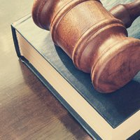 Gavel on top of book