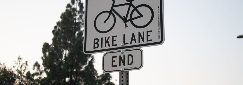 Bike lane end sign
