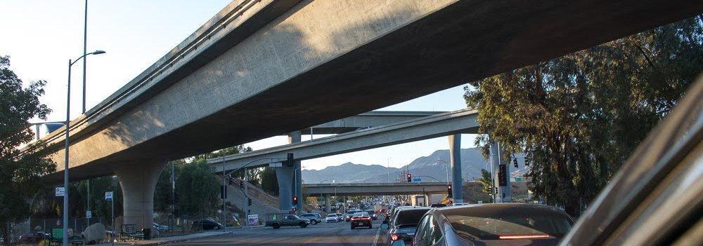 Cars going under an underpasss