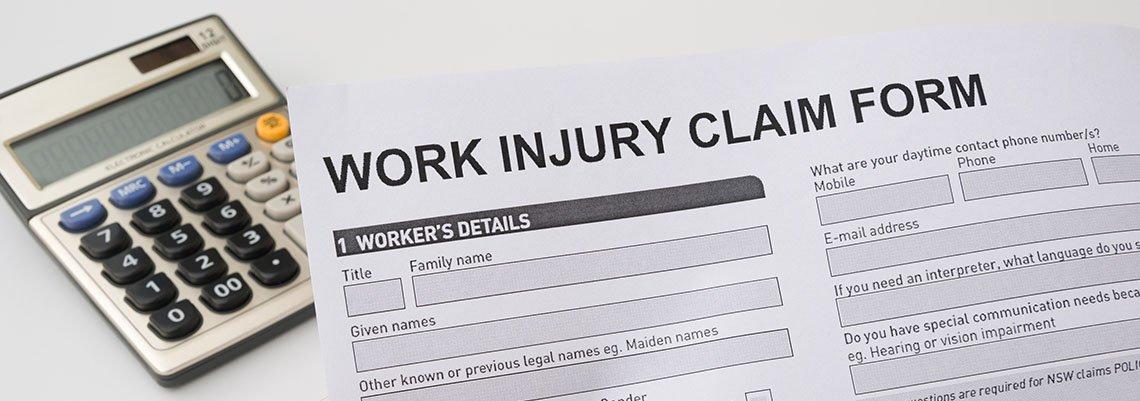 Work Injury Claim Form next to a calculator
