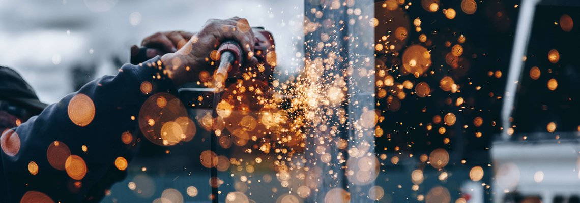 Sparks flying from a worker using a power tool.jpg