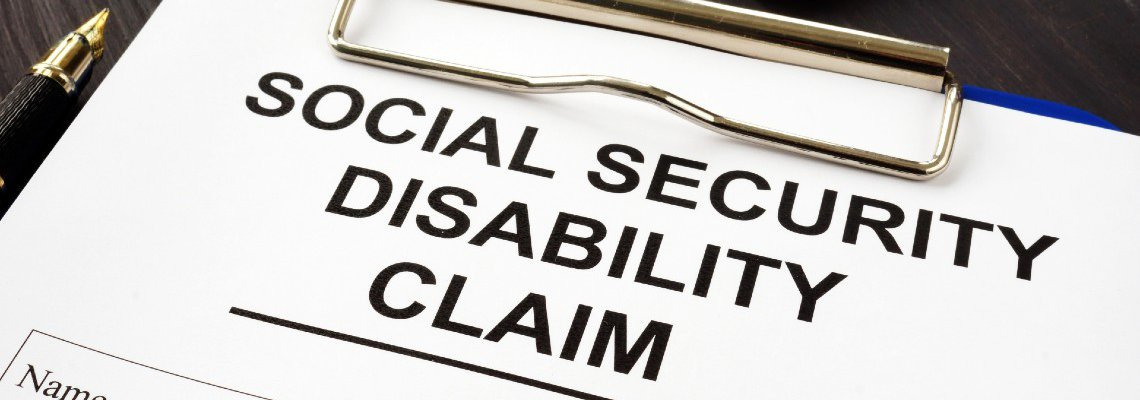 Social Security Disability Claim Form Next to Pen