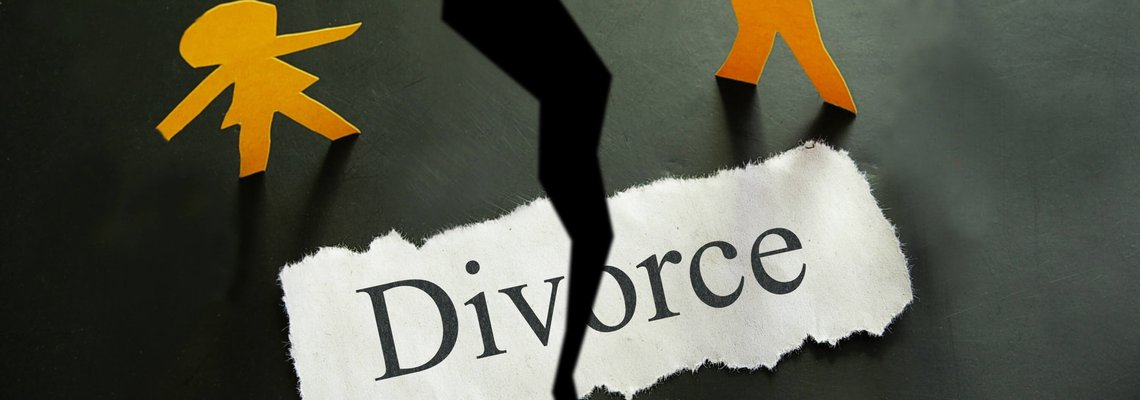Torn piece of paper with divorce text and paper couple figures.jpeg