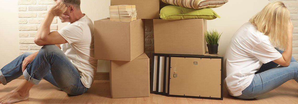 Stack of boxes diving upset man and woman