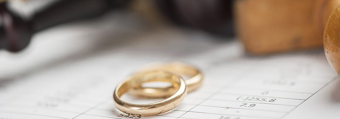 Pair of wedding rings with a gavel in the background