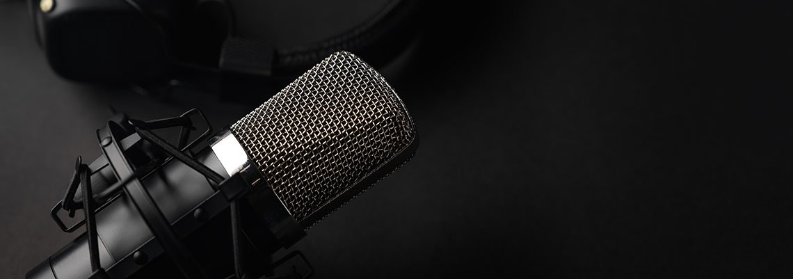 Podcast microphone on a black background