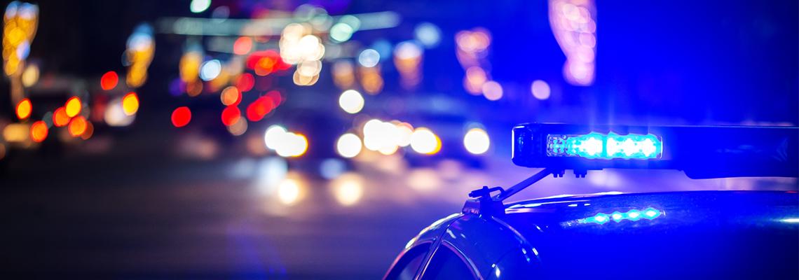 night police car lights in city