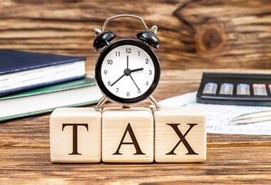 Conservatorship — Word Tax with Clock on the Office Workplace in Independence, MO