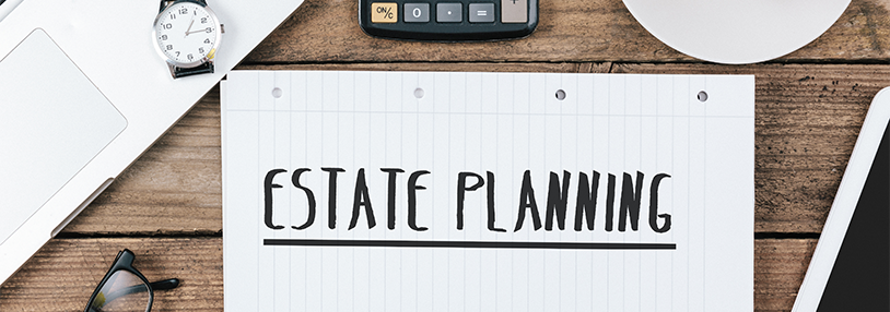 The words estate planning written on a notebook