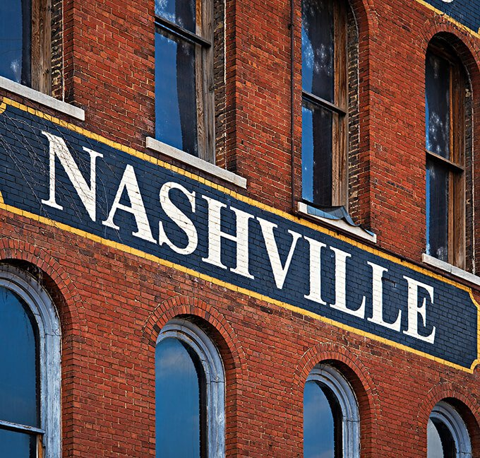 Nashville sign painted on the side of a brick building