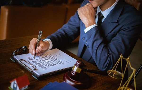 Attorney writing at his desk