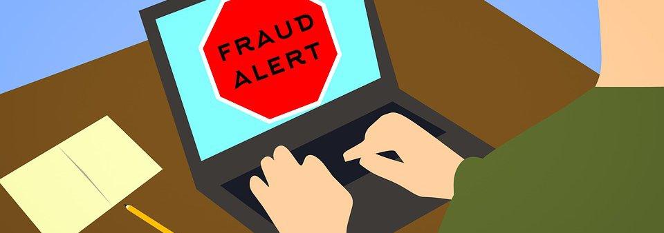 Fraud alert on laptop