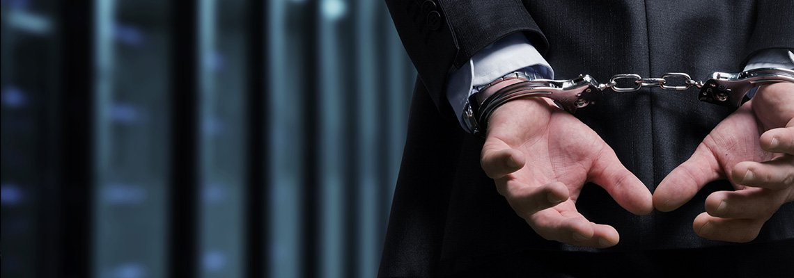 A man in handcuffs behind his back
