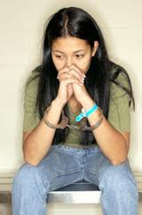 Girl sitting with her hands folded