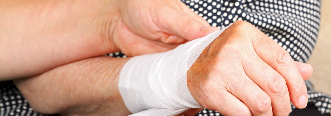 Elderly Person getting their hand wrapped