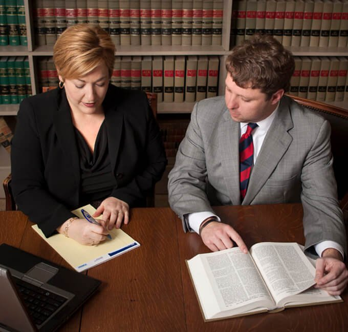 Attorney Nancy Thomason and Christopher Pracht Working Together at a Desk
