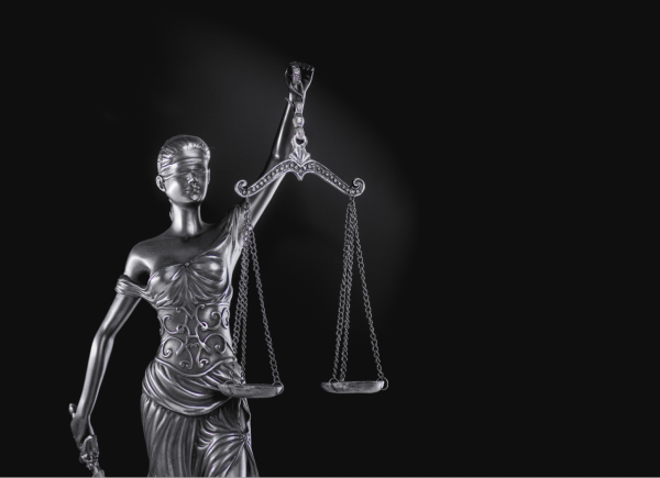 Lady Justice Holding Scales in Black and White