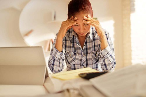 Woman Frustrated Over Paperwork
