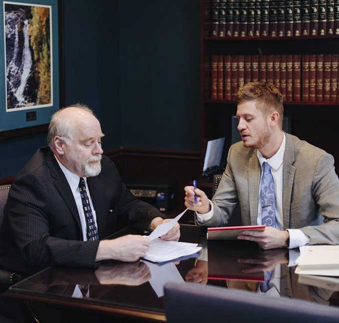 Cody Crane and Gary E. Tibble working at a desk together