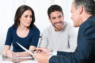 couple talking to estate attorney